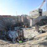 Crews prepare foundation pilings for the pile cap construction.